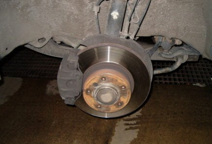 Left front wheel removed and the brake disc together with the brake caliper are visible.
