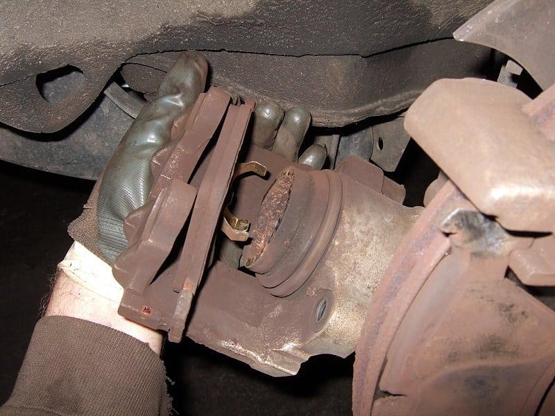 Remove the inner brake pad from the brake caliper.
