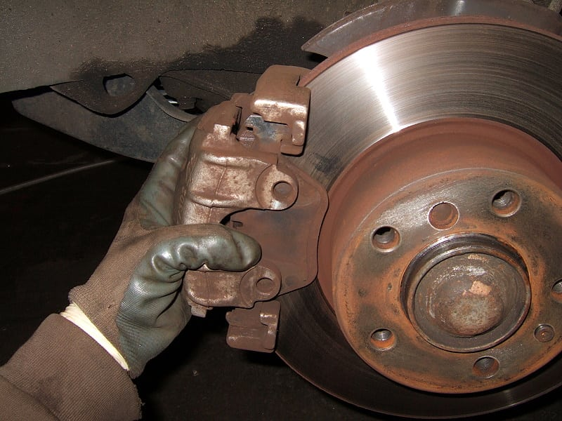 Pull the brake caliper straight out (the inner brake pad will follow and the outer brake pad will stay).