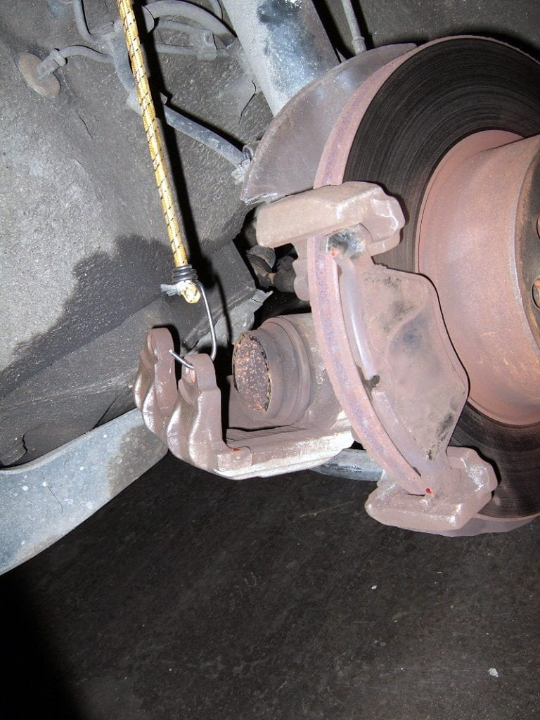 Support the brake caliper with a bungee cord or similar.