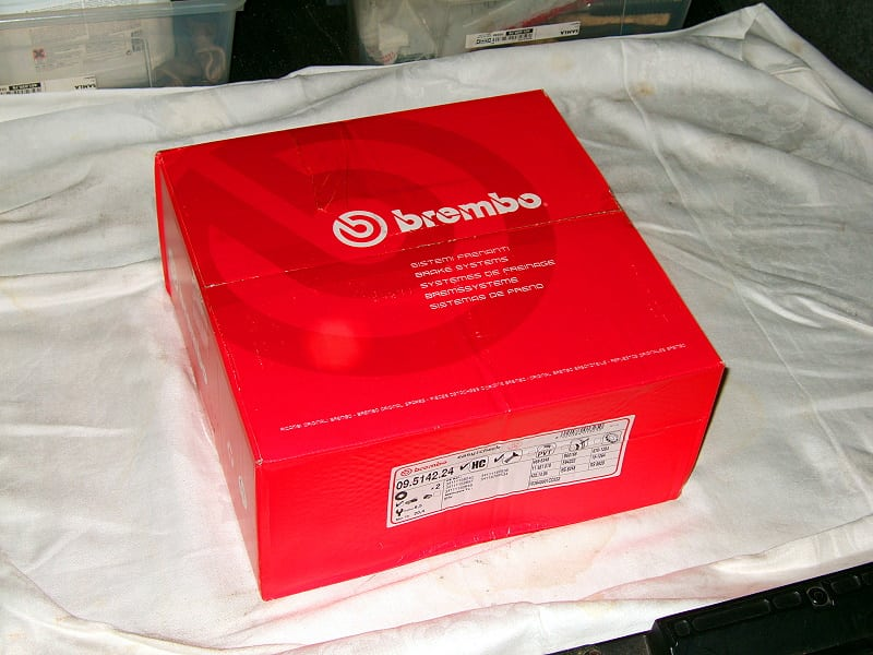 New Brembo brake discs to be unpacked and installed.