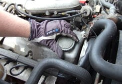 Remove the engine oil filler cap (to aid the draining).